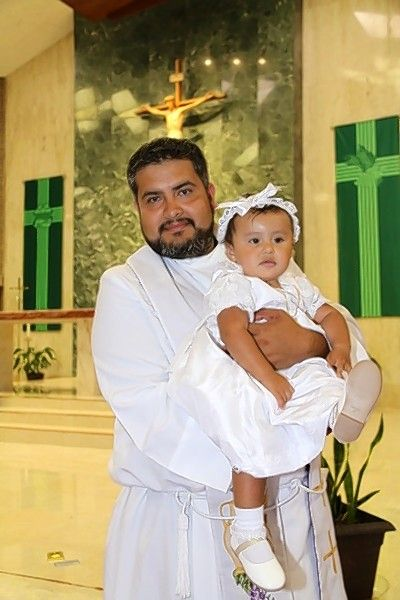 The Rev. Manuel Gomez baptized two of his cousin's children in the Chicago area, including Adriana Gomez-Martinez's youngest daughter, Nayeli.