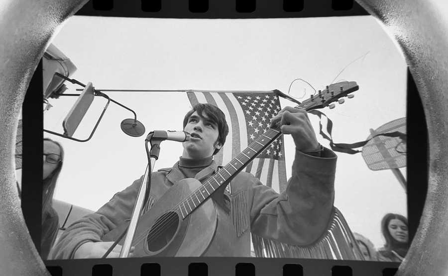 "The Daily Herald Archive, Assignment # 15,584, Bob Finch photo: ""Give Peace a Chance"" and other anti-war ballads filed the cold air at Kopp Park during a sparsely attend peace rally in Prospect Heights in December of 1969. 40 people attended and the Northwest Suburban Peace Coalition of Students fore Peace called the demonstration a success."