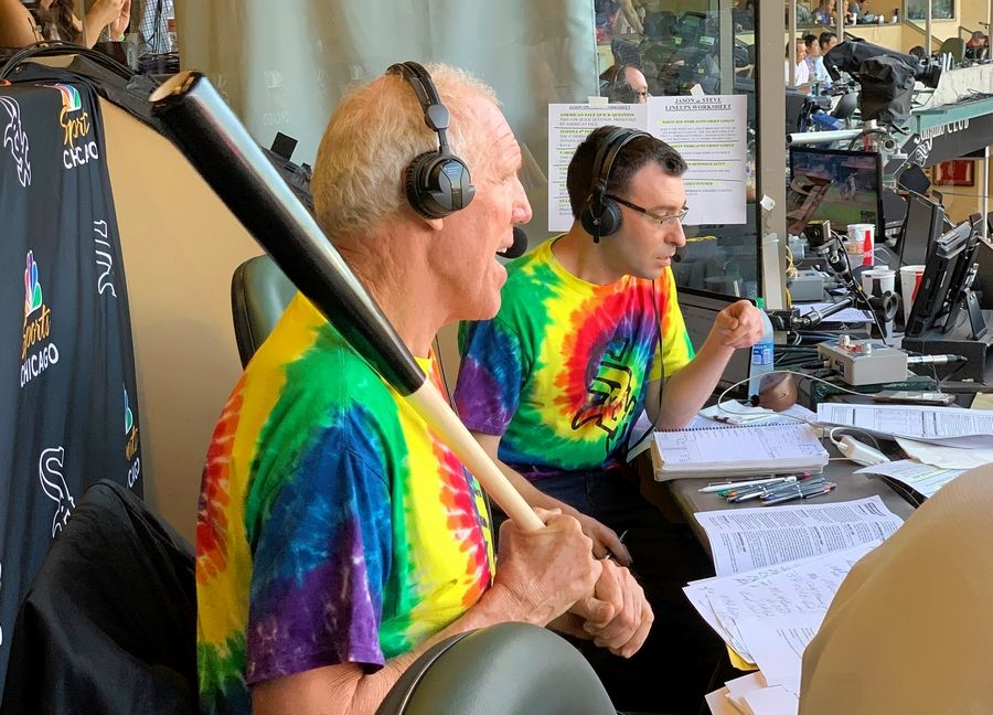 Bill Walton does commentary on NBC Sports Chicago for the Chicago White Sox's baseball game against the Los Angeles Angels on Friday, Aug. 16, 2019, in Anaheim, Calif. Walton was calling the game on an invitation from the White Sox and announcer Jason Benetti, right.