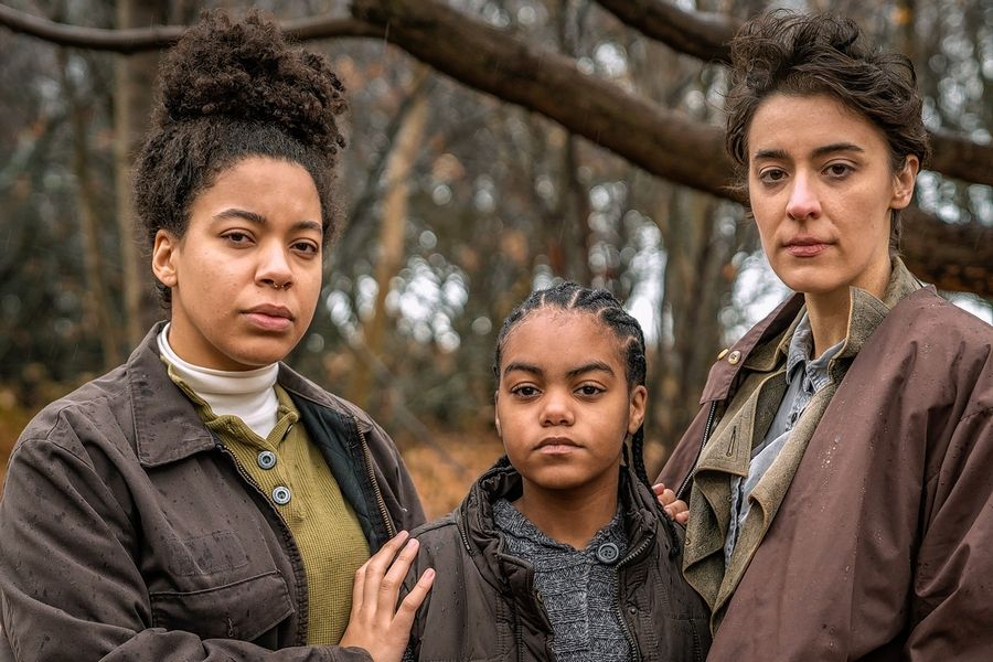 "Tracie Taylor, left, and Laura Resinger play the parents of a young boy (Saniyah As-Salaam), center, in the post-apocalyptic drama ""Thirst"" at Strawdog Theatre Company."