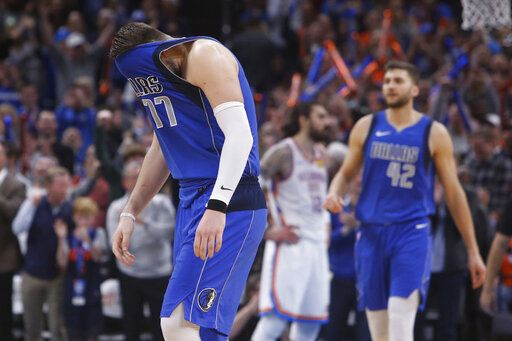 Dallas Mavericks forward Luka Doncic (77) pulls his jersey over his face after missing a shot late in the second half of the team's NBA basketball game against the Oklahoma City Thunder on Tuesday, Dec. 31, 2019, in Oklahoma City.