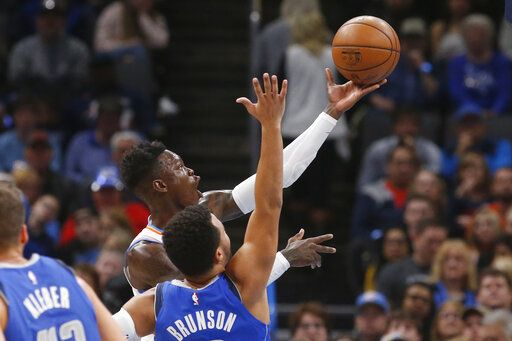Oklahoma City Thunder guard Dennis Schroeder, rear, shoots in front of Dallas Mavericks guard Jalen Brunson during the first half of an NBA basketball game Tuesday, Dec. 31, 2019, in Oklahoma City.