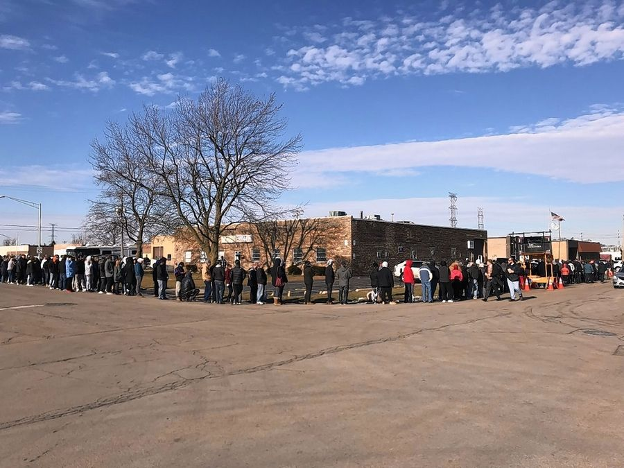 Hundreds of customers lined up outside EarthMed marijuana dispensary in Addison on the state's second day of recreational sales.
