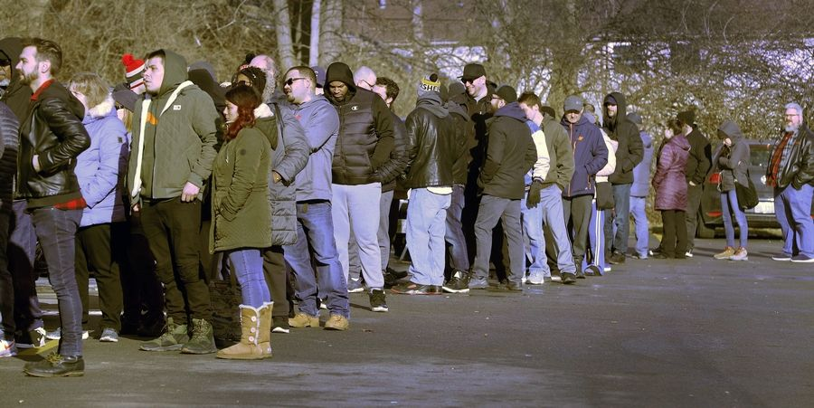 A long line wraps through the parking lot Thursday at Verilife Illinois Marijuana Dispensary in North Aurora on the second day of recreational cannabis sales in the state. Officials say more than 77,000 people purchased cannabis on New Year's Day in Illinois.