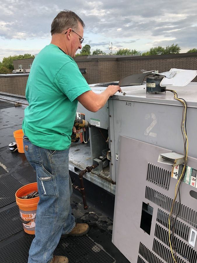 Lake Villa District 41 will ask voters in March to approve borrowing for various school building projects. Here, a rooftop unit at Hooper School is repaired.