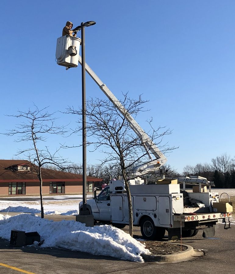 Crews install exterior lighting at Thompson school. Lake Villa District 41 will ask voters for authorization to borrow money for school building projects.
