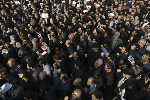 "Protesters demonstrate over the U.S. airstrike in Iraq that killed Iranian Revolutionary Guard Gen. Qassem Soleimani in Tehran, Iran, Jan. 3, 2020. Iran has vowed ""harsh retaliation"" for the U.S. airstrike near Baghdad's airport that killed Tehran's top general and the architect of its interventions across the Middle East, as tensions soared in the wake of the targeted killing."