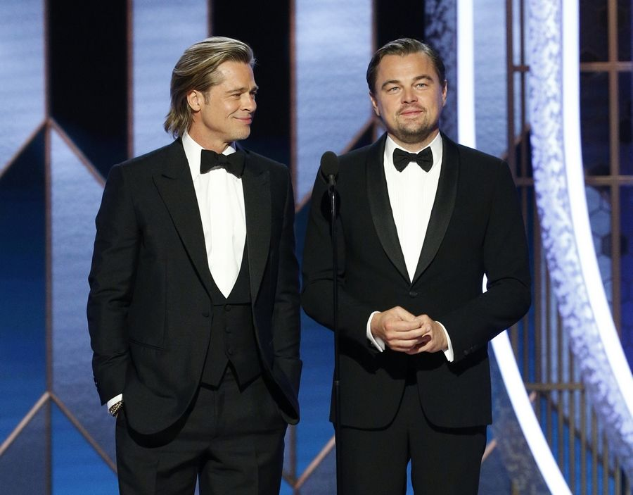 This image released by NBC shows presenters Brad Pitt, left, and Leonardo DiCaprio at the 77th Annual Golden Globe Awards at the Beverly Hilton Hotel in Beverly Hills, Calif., on Sunday, Jan. 5, 2020.