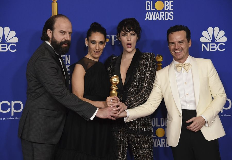 "Brett Gelman, from left, Sian Clifford, Phoebe Waller-Bridge and Andrew Scott, from the cast of ""Fleabag,"" pose in the press room with the award for best television series, musical or comedy, at the 77th annual Golden Globe Awards at the Beverly Hilton Hotel on Sunday, Jan. 5, 2020, in Beverly Hills, Calif."