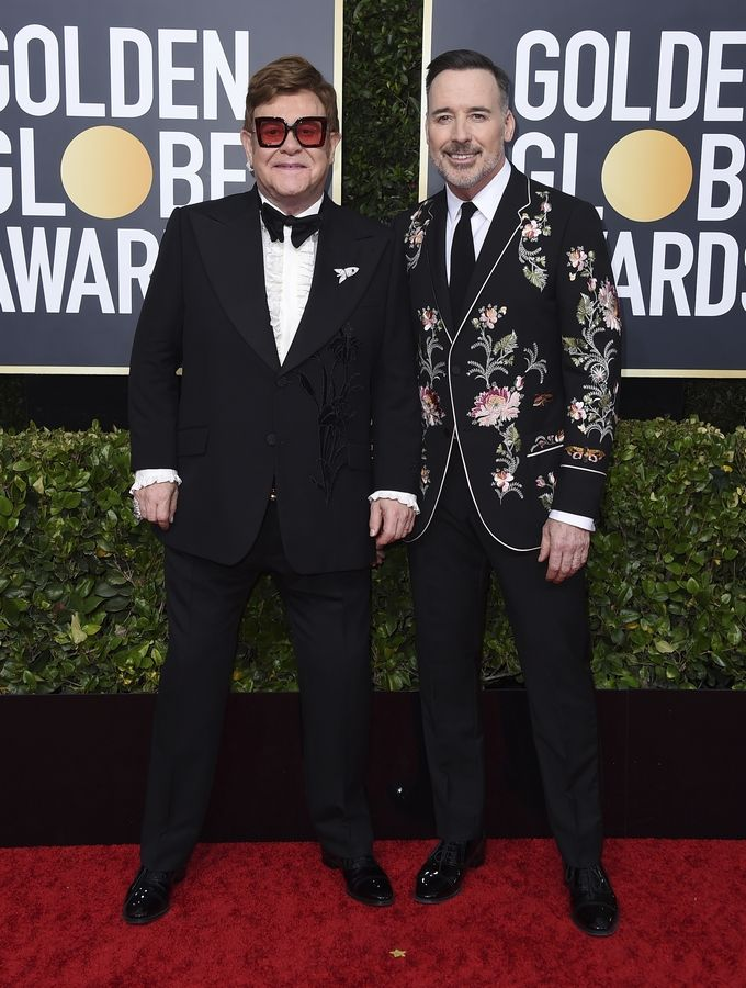 Elton John, left, and David Furnish arrive at the 77th annual Golden Globe Awards at the Beverly Hilton Hotel on Sunday, Jan. 5, 2020, in Beverly Hills, Calif.