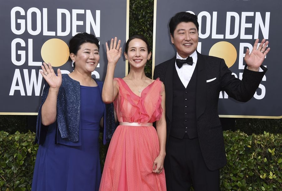Lee Jeong-eun, from left, Cho Yeo-jeong and Kang-Ho Song arrive at the 77th annual Golden Globe Awards at the Beverly Hilton Hotel on Sunday, Jan. 5, 2020, in Beverly Hills, Calif.