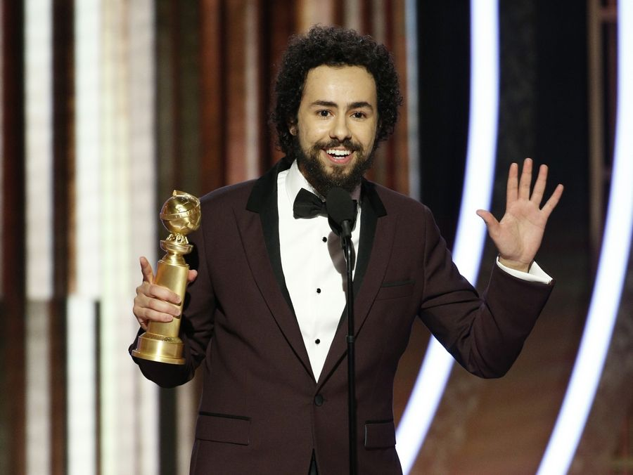 "This image released by NBC shows Ramy Youssef accepting the award for best actor in a TV series, comedy or musical for ""Ramy"" at the 77th Annual Golden Globe Awards at the Beverly Hilton Hotel in Beverly Hills, Calif., on Sunday, Jan. 5, 2020."