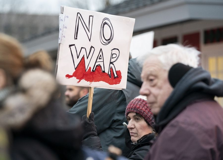 Carolyn Bonistalli, of Western Springs, participates during an anti war rally to protest the latest tensions with Iran on Sunday along the Naperville Riverwalk in Naperville.