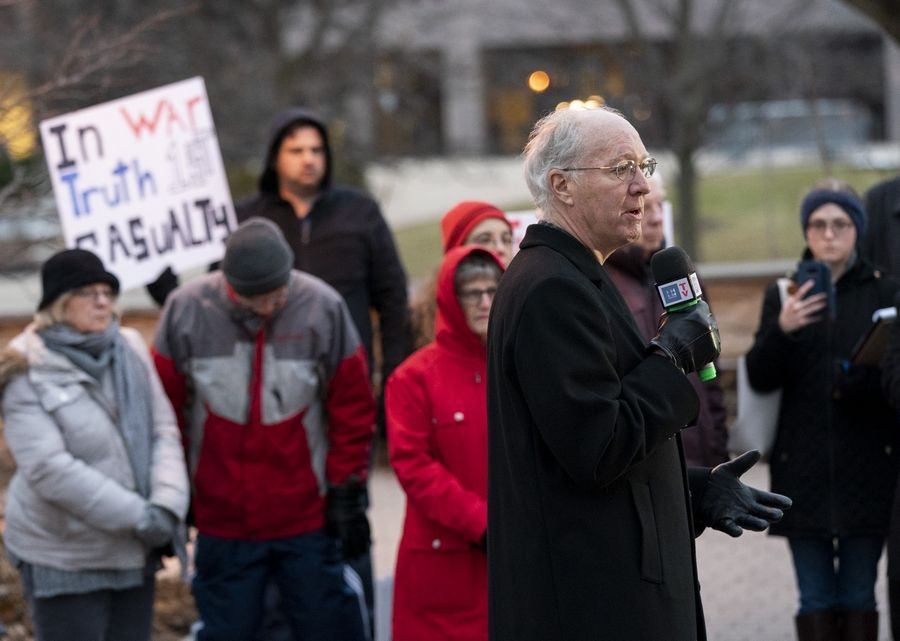 U.S. Rep. Bill Foster, an Illinois Democrat, delivers remarks during an anti-war rally to protest the latest tensions with Iran on Sunday along the Naperville Riverwalk in Naperville.