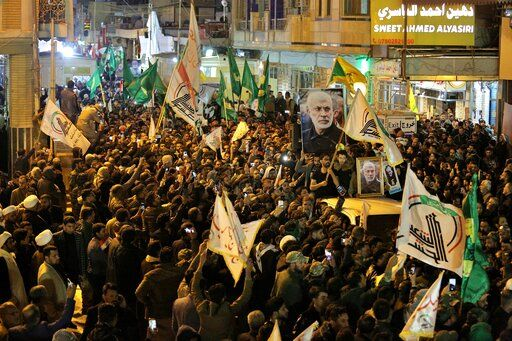 "Mourners carry the coffins of Iran's Gen. Qassem Soleimani and Abu Mahdi al-Muhandis, deputy commander of Iran-backed militias at the Imam Ali shrine in Najaf, Iraq, Saturday, Jan. 4, 2020. Iran has vowed ""harsh retaliation"" for the U.S. airstrike near Baghdad's airport that killed Tehran's top general and the architect of its interventions across the Middle East, as tensions soared in the wake of the targeted killing."