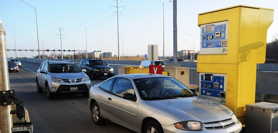 Drivers use the new automatic toll collection machines at an on-ramp along the westbound Jane Addams Tollway.