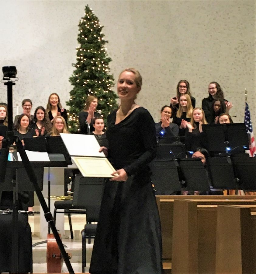 Woodlands Academy Symphonic Orchestra conductor Lauren Moldenhauer displays the Illinois Council of Orchestras Board Leadership Award she received during the Lake Forest all-girls college-prep high school's Christmas concert Dec. 12.