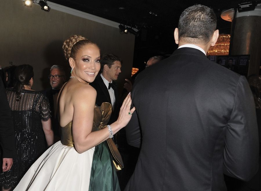 Jennifer Lopez, left, and Alex Rodriguez walk into Sunday's 77th annual Golden Globe Awards.