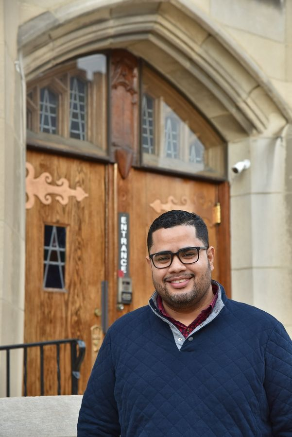 Pastor Abi Raices of New Life Covenant Church stands at the main entrance of First United Methodist Church in Elgin, where Raices' church will take over operations of an emergency winter shelter for the homeless.