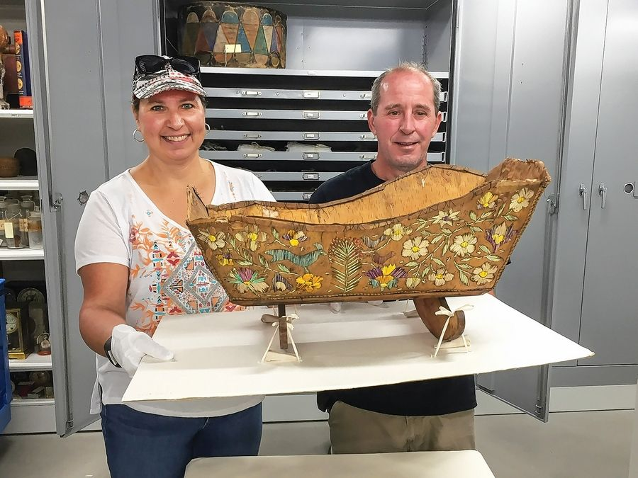Terri Hom and Pat Kruse researched this mid-19th century birchbark and quillwork cradle from the Dunn Museum's Native American collection.
