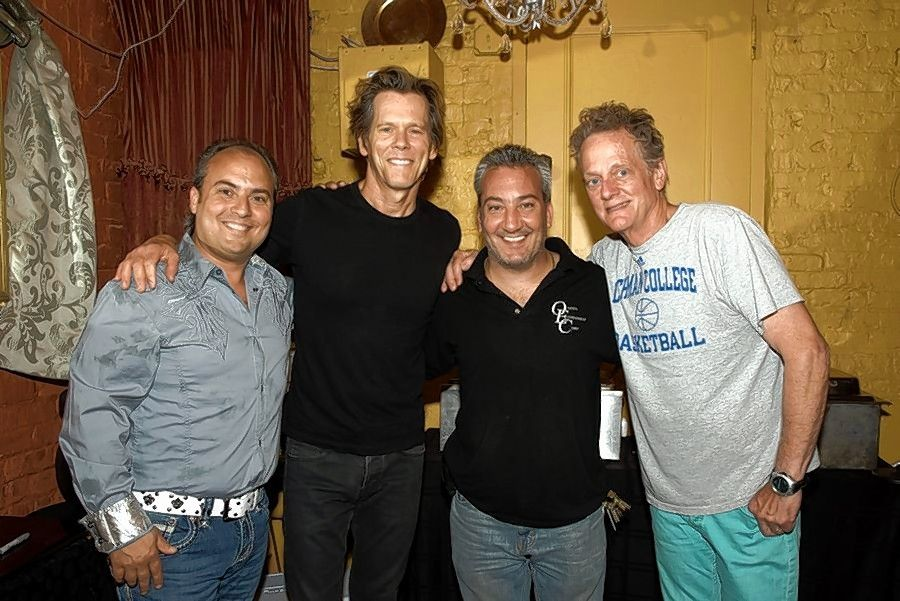 Ron Onesti, left, and his brother, Rich, second from right, backstage with the Bacon Brothers band, Kevin and Michael Bacon.