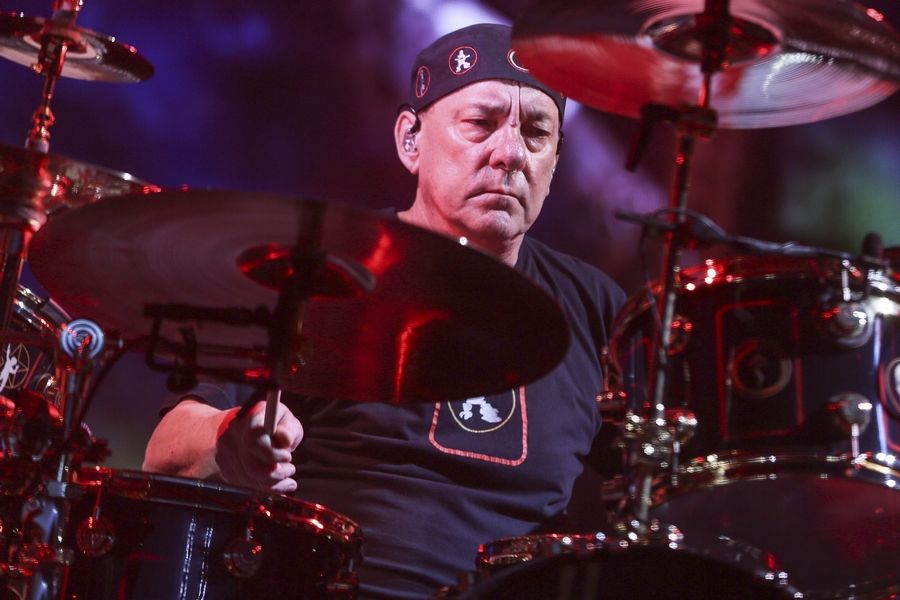 FILE - This Aug. 1, 2015 file photo shows Neil Peart of Rush performing during the final show of the R40 Tour in Los Angeles. Peart, the renowned drummer and lyricist from the band Rush, has died. His rep Elliot Mintz said in a statement Friday that he died at his home Tuesday, Jan. 7, 2020 in Santa Monica, Calif. He was 67.