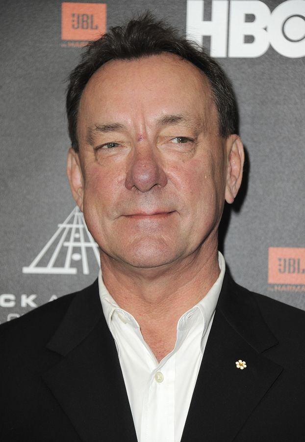 FILE - This April 18, 2013 file photo shows Neil Peart at the Rock and Roll Hall of Fame Induction Ceremony in Los Angeles. Peart, the renowned drummer and lyricist from the band Rush, has died. His rep Elliot Mintz said in a statement Friday that he died at his home Tuesday, Jan. 7, 2020 in Santa Monica, Calif. He was 67.