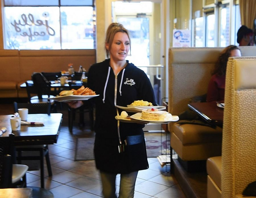 Nikki Formanski waits tables Thursday morning at Jelly Cafe in Mount Prospect. Earlier this week, she was surprised by a $2,020 tip from one of her loyal customers.