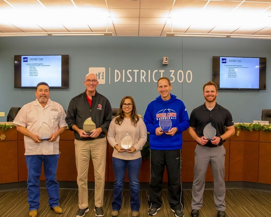 Dundee-Crown High School maintenance employee Jesse Martinez, left, coach Bob Sweeney, athletic trainer Brenna Tschida, Ccach Lance Huber and coach Connor Loehrke were honored with lifesaving awards in December by Community Unit District 300.