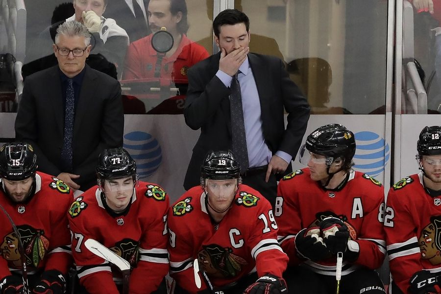Chicago Blackhawks head coach Jeremy Colliton, top right, reacts during the third period of an NHL hockey game against the Nashville Predators in Chicago, Thursday, Jan. 9, 2020.