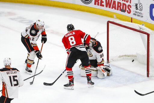 Chicago Blackhawks left wing Dominik Kubalik (8) scores past Anaheim Ducks goaltender John Gibson (36) during the second period of an NHL hockey game Saturday, Jan. 11, 2020, in Chicago.