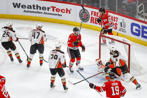 Chicago Blackhawks left wing Dominik Kubalik (8) raises his stick after scoring against the Anaheim Ducks during the second period of an NHL hockey game Saturday, Jan. 11, 2020, in Chicago.