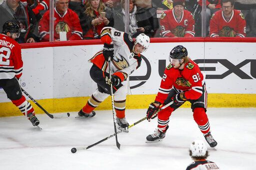 Chicago Blackhawks left wing Alex Nylander (92) works for the puck against Anaheim Ducks center Isac Lundestrom (48) during the second period of an NHL hockey game Saturday, Jan. 11, 2020, in Chicago.