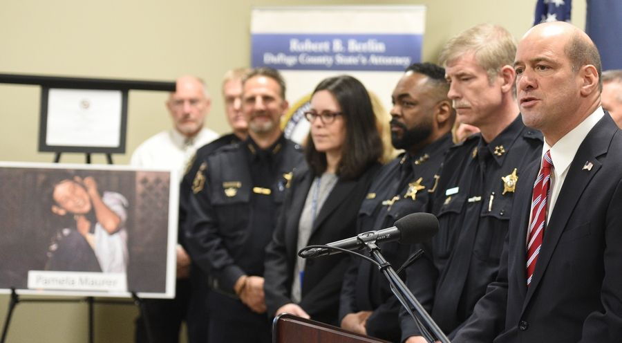 DuPage County State's Attorney Robert Berlin, right, speaks during a news conference Monday announcing that police have solved the 1976 murder of 16-year-old Pamela Maurer and have named Bruce Lindahl the killer. Lindahl, who died himself in 1981, is believed responsible for multiple murders and rapes.