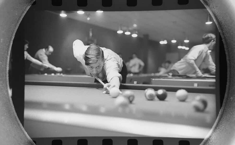 The Daily Herald Archive, Assignment # 12,775, Bob Finch photo: Jim Arnold of Hoffman Estates lines up his next shot at the Schaumburg Jaycees junior pocket billiards tournament. The tournament was held at the Diamond Cue Club in Hoffman Estates in March of 1969.