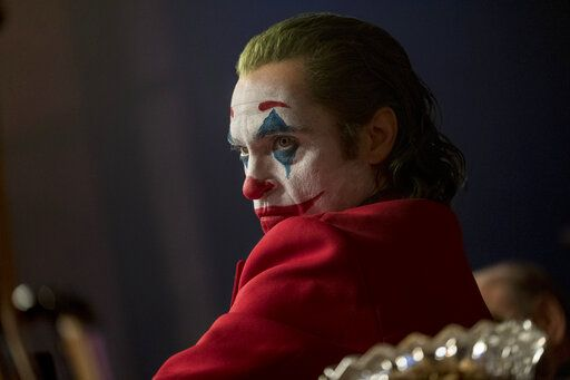 "This image released by Warner Bros. Pictures shows Joaquin Phoenix in a scene from ""Joker.""  On Monday, Jan. 13, Phoenix was nominated for an Oscar for best actor for his role in the film. (Niko Tavernise/Warner Bros. Pictures via AP)"