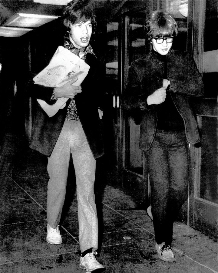 Mick Jagger and Peter Asher.