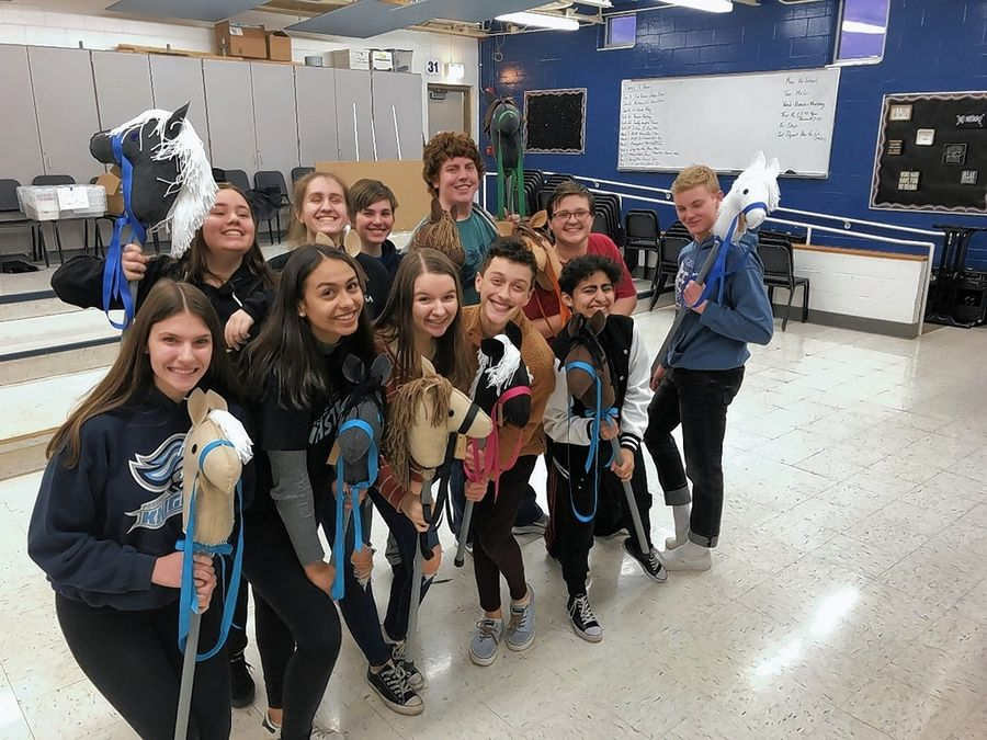 "Students at Prospect High School show off the horses they made for the original play ""Horse Play,"" written by Prospect alum Laura Winters."