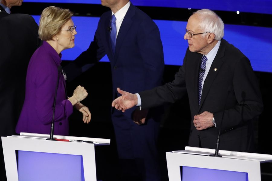 Democratic presidential candidate Sen. Elizabeth Warren, D-Mass., left and Sen. Bernie Sanders, I-Vt., appear to have a tense exchange Tuesday, Jan. 14, 2020, after a Democratic presidential primary debate hosted by CNN and the Des Moines Register in Des Moines, Iowa.