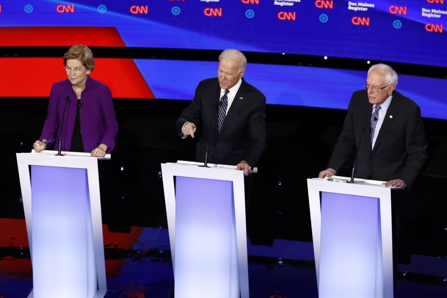 Democratic presidential candidates Sen. Elizabeth Warren, D-Mass., from left, former Vice President Joe Biden and Sen. Bernie Sanders, I-Vt., on stage, Tuesday, Jan. 14, 2020, during a Democratic presidential primary debate hosted by CNN and the Des Moines Register in Des Moines, Iowa.