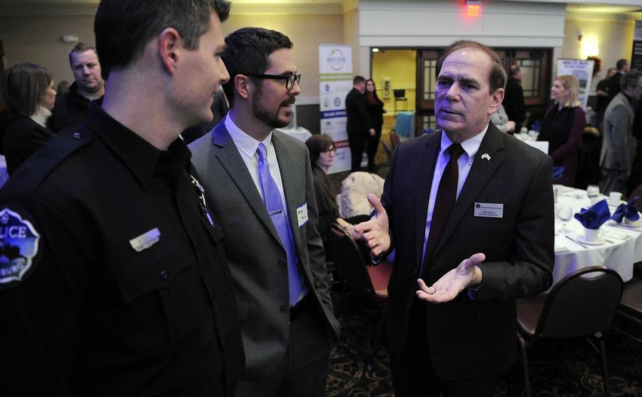 Schaumburg Mayor Tom Dailly talks with his sons, Mike and Matt, before his first State of the Village address Tuesday at the Schaumburg Business Association's January breakfast meeting.