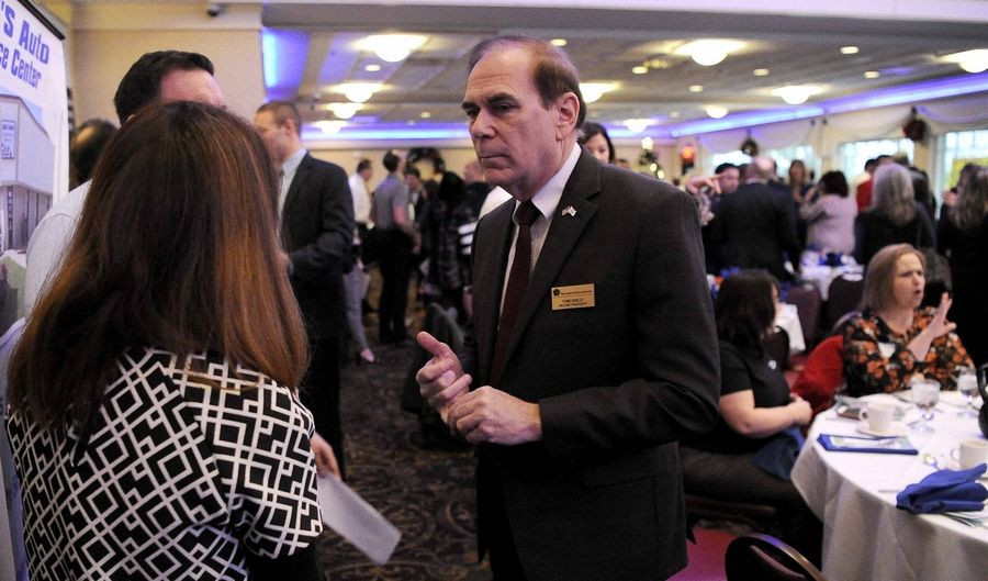 Schaumburg Mayor Tom Dailly speaks with members of the local business community Tuesday after giving his first State of the Village address at the Schaumburg Business Association's January breakfast meeting.