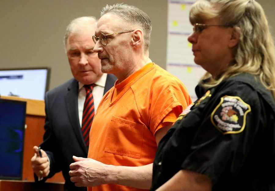 Andrew Freund, center, and defense lawyer Henry Sugden, left, appear in court Tuesday for a status hearing before McHenry County Judge Robert Wilbrandt.
