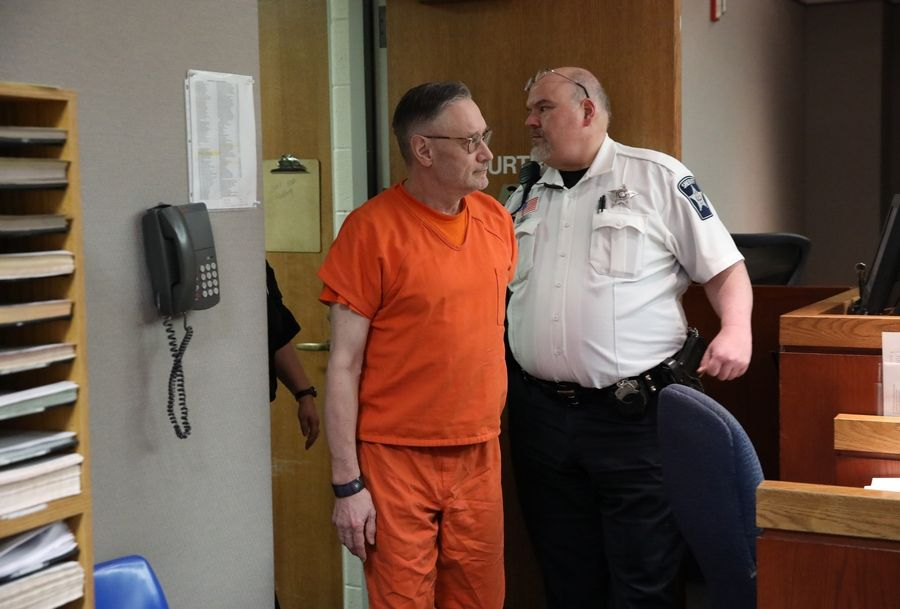 Andrew Freund enters court Tuesday for a status hearing on charges he murdered his 5-year-old son, AJ, in April 2019. The hearing was the first time media cameras have been allowed in a McHenry County courtroom.