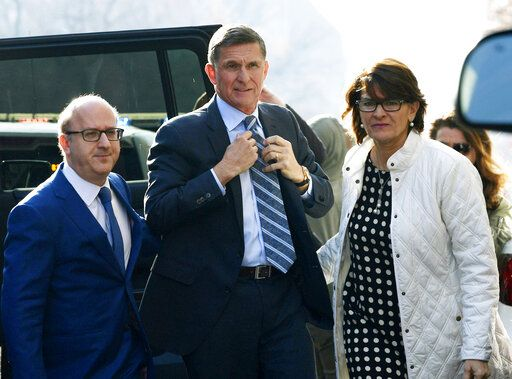 FILE - In this Dec. 1, 2017, file photo, Michael Flynn, center, arrives at federal court in Washington.