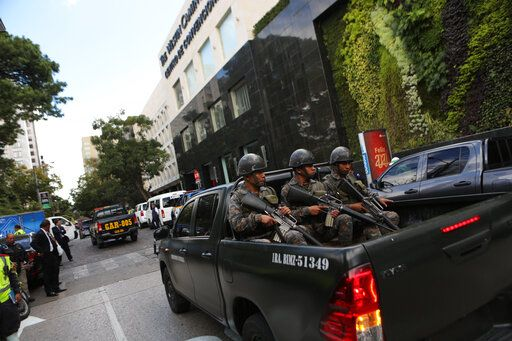 Soldiers patrol near the hotel where diplomats are staying before the inauguration of the new president of Guatemala, Alejandro Giammattei, in Guatemala City, Tuesday, Jan. 14, 2020. Guatemala will swear-in Giammattei, a conservative physician opposed to gay marriage and abortion, as its new president Tuesday while the country's outgoing leader exits amid swirling corruption accusations.