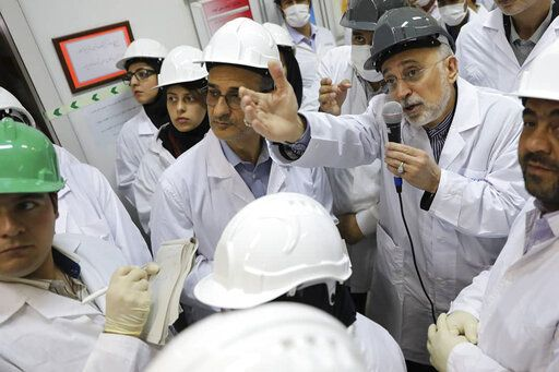 FILE - In this file photo released Nov. 4, 2019 by the Atomic Energy Organization of Iran, Ali Akbar Salehi, head of the organization, speaks with media while visiting Natanz enrichment facility, in central Iran. The landmark 2015 deal between Tehran and world powers meant to prevent Iran from obtaining nuclear weapons has been teetering on the edge of collapse since the U.S. pulled unilaterally in 2018. The EU said Wednesday, Jan. 8, 2020, that it will 'œspare no effort'� to keep the deal alive, but with tensions between the U.S. escalating into open hostilities it's seeming increasingly unlikely that will be possible.  (Atomic Energy Organization of Iran via AP, File)