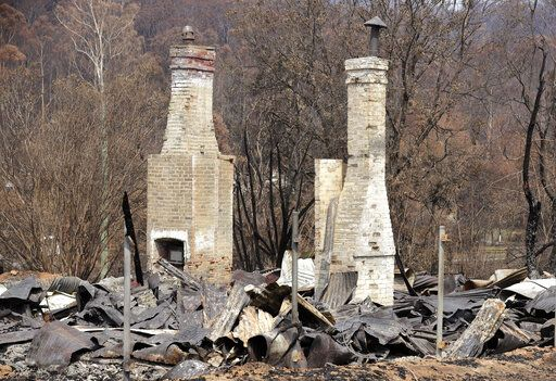 Two brick fireplaces are all that are left of a historic town store at Nerrigundah, Australia, Monday, Jan. 13, 2020, after a wildfire ripped through the town on New Year's Eve. The tiny village of Nerrigundah in New South Wales has been among the hardest hit by Australia's devastating wildfires, with about two thirds of the homes destroyed and a 71-year-old man killed.