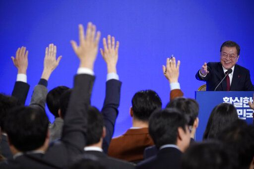 South Korean President Moon Jae-in smiles as reporters raise their hands for questions during his New Year press conference at the presidential Blue House in Seoul, South Korea, Tuesday, Jan. 14, 2020. (Kim Hong-Ji/Pool Photo via AP)