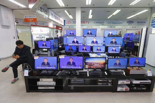 TV screens show the live broadcast of South Korean President Moon Jae-in's New Year press conference at the Yongsan Electronic store in Seoul, South Korea, Tuesday, Jan. 14, 2020. Moon said Tuesday he could push for exemptions of U.N. sanctions placed on North Korea as a way to promote an expansion of inter-Korean ties that he says would help restart nuclear negotiations between Pyongyang and Washington.